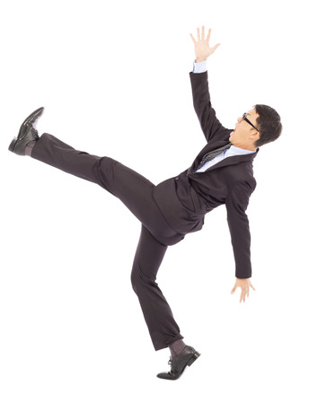 exaggerate: businessman slip and fall and  a funny pose Stock Photo