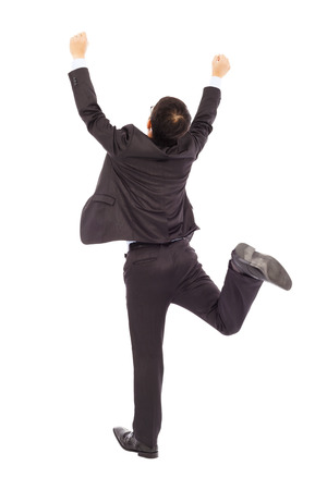 businessman jumping: excited businessman raising hands to celebrate