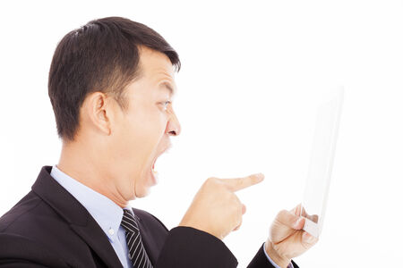 businessman holding a tablet and screaming to point it photo
