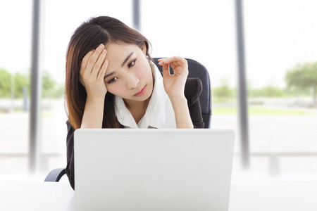 young business woman feel tired and holding head photo