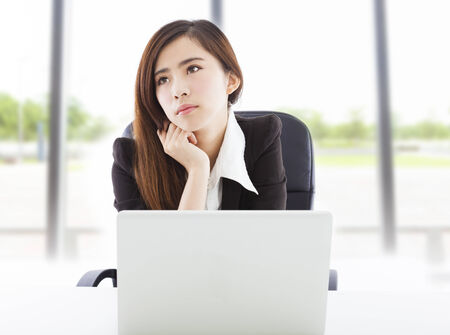 young business woman feel unhappy in the office photo