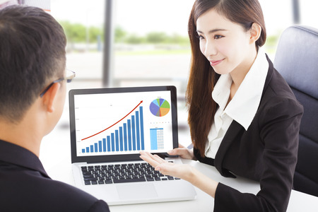 Business woman showing stock market financial situation Stock Photo