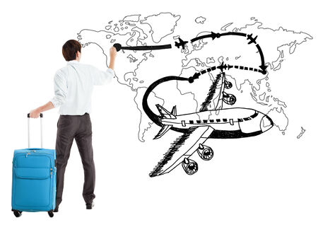 young businessman drawing airplane and airline path on the map Stock Photo - 28490334