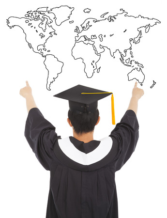 graduation man wearing a mortarboard and point to world