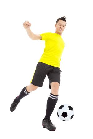 football socks: Soccer player kicking ball Stock Photo