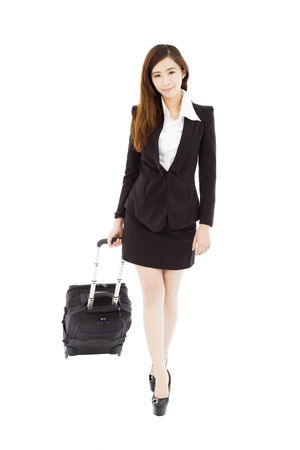 smiling businesswoman walking and carrying the baggage photo