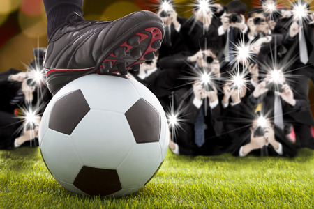 soccer pitch: many photographer taking winner soccer player feet on field Stock Photo