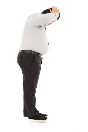 fat business man too unbelievable his weight to hold head photo