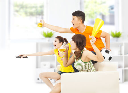 young people so excited to yelling  and while watching soccer game photo