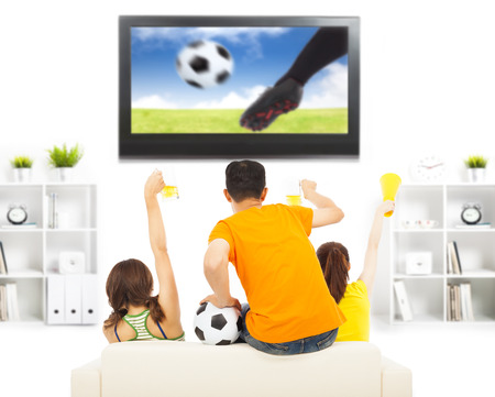 young fans yelling  and while watching soccer game photo