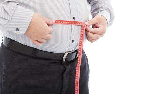 脂肪ビジネスの男は、彼のウエストを測定するためにスケールを使用
