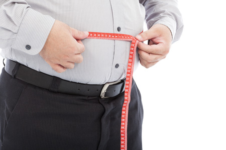 fat business man use scale to measure his waistline photo