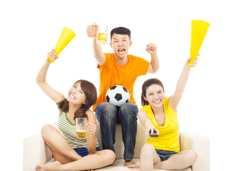 watching football: young people shouting to encourage their  team  win Stock Photo