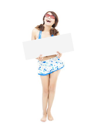 young girl wearing a swimwear  and holding a white board photo