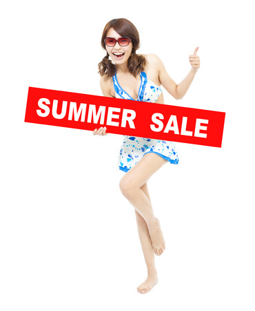 happy bikini girl holding a sign of  summer sale. Its time to go shopping photo