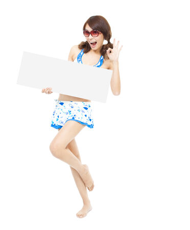 happy sunshine woman holding a board and ok gesture photo