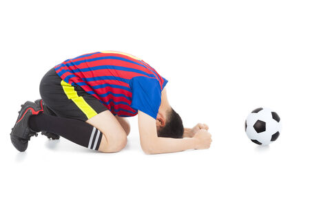 kneel down: soccer player lose the game and kneel down Stock Photo