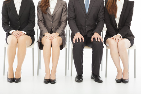 business people waiting for job interview over white  photo