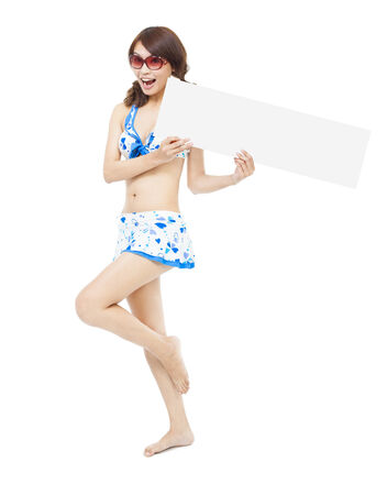pretty sunshine girl standing and holding a board  photo