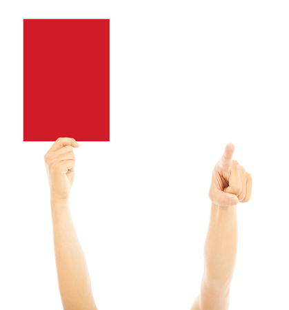punitive: Hand of referee with big red card and point the direction