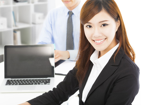 pretty professional young woman with colleague in office photo