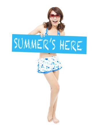 happy sunny bikini girl standing and holding a board photo