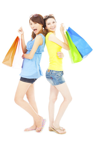 asian girl shopping:  happy young sisters standing and holding shopping bags Stock Photo