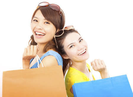 happy young women with shopping bags photo