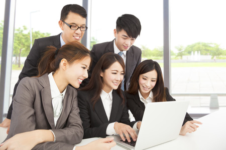 happy asian business team working in office photo