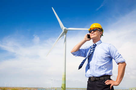 professional business standing with wind generator  photo