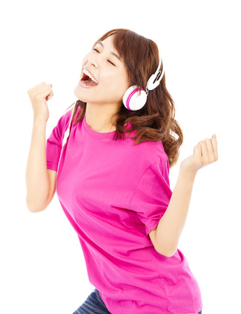 Young beautiful woman enjoying the music and dancing photo