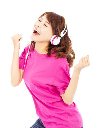 Young beautiful woman enjoying the music and dancing photo