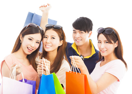 group of happy young people with shopping bags photo