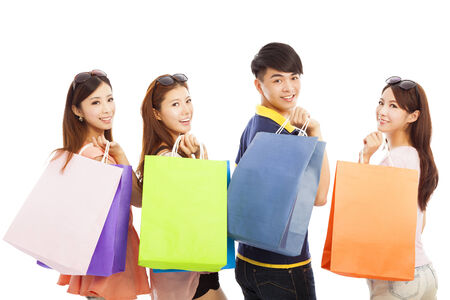 happy young people with shopping bags photo