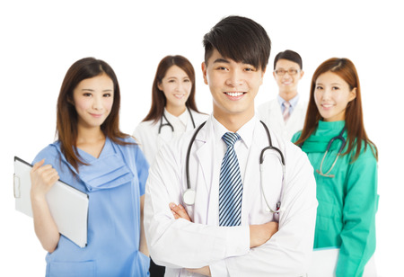 healthcare asian: Professional medical doctor team standing over white background