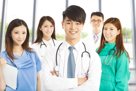 sufferer: Professional medical doctor team standing over white background
