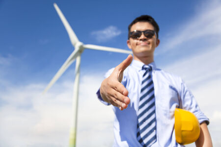 business man handshake cooperate to do wind power fuel photo