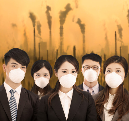 air demonstration: business people was wearing a mask with air pollution background