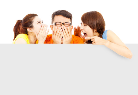 two girl talk to young man about surprising news photo