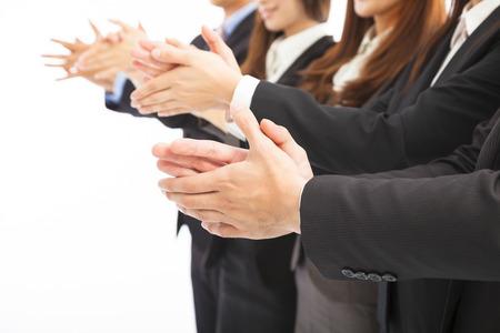 manos aplaudiendo: la gente de negocios aplaudiendo en el fondo blanco aislado Foto de archivo