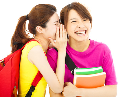 young student talking to his friend with happy expression photo