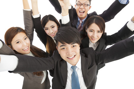 happy young success business team raise hands photo