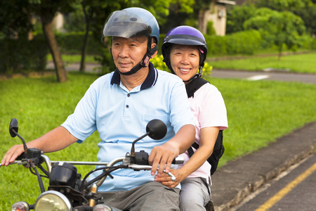 senior couple drive motorcycle to travel photo
