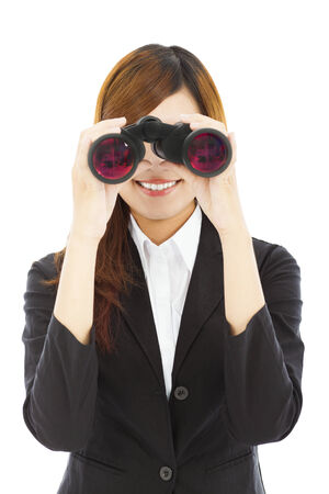 Attractive business woman with binoculars photo