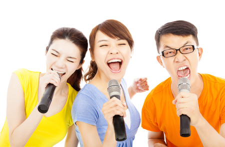 crazy woman: happy young group having fun singing with karaoke