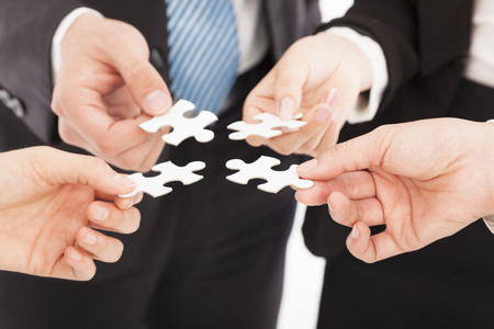 communication metaphor: Business people Holding Jigsaw Puzzle