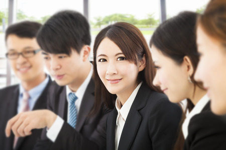 shot of focus on young business woman with colleagues photo