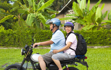 asian senior couple driving motorcycle to travel Stock Photo - 29672679