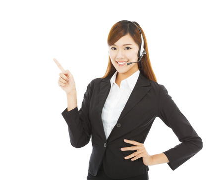 smiling business woman with headphone and point up