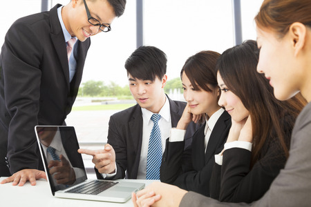 business man use laptop to present report to colleague Stock Photo